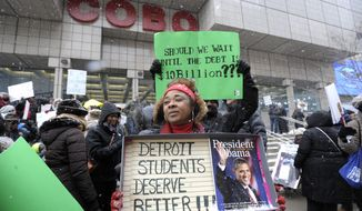 Western International High School teacher Debrah Baskin, 53, of Southfield, and other teachers from Detroit area schools protest outside the Cobo Center, in this Wednesday, Jan. 20, 2106, file photo, only hours before President Barack Obama's visit to the auto show. (Todd McInturf/Detroit News via AP)