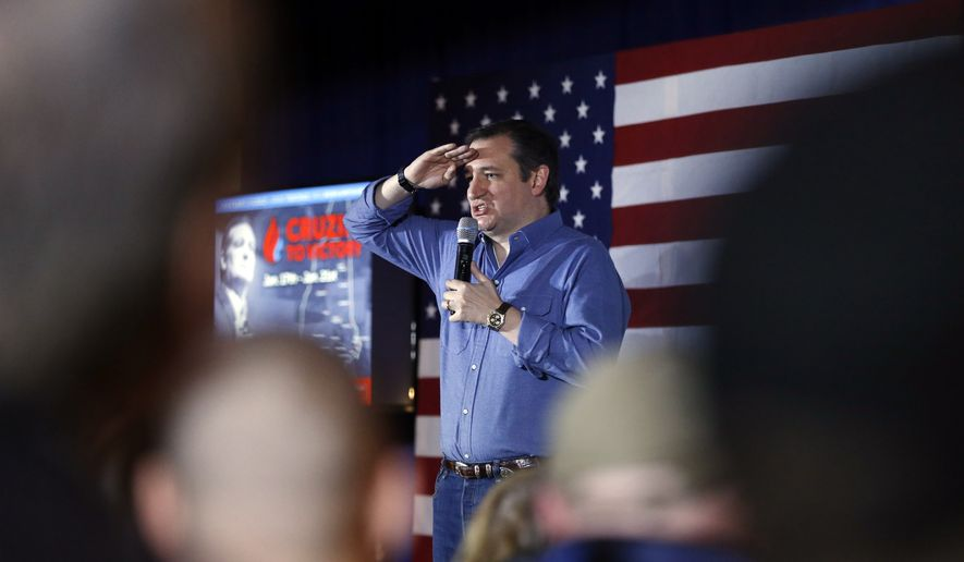 Republican presidential candidate Sen. Ted Cruz, R-Texas, salutres during a campaign stop Wednesday, Jan. 20, 2016, in Hollis, N.H. (AP Photo/Matt Rourke)