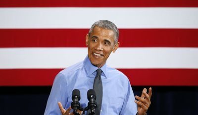 President Barack Obama reacts while speaking at the United Auto Workers-General Motors Center for Human Resources, Wednesday, Jan. 20, 2016 in Detroit. While in Detroit the president visited the 2016 North American International Auto Show and speak of the progress made by the city, its people and neighborhoods, and the American auto industry. (AP Photo/Paul Sancya)