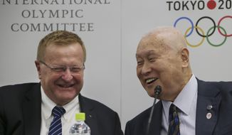 International Olympic Committee (IOC) Vice President and IOC Coordination Commission for Tokyo 2020 Chair John Coates, left, and Tokyo 2020 Olympics President Yoshiro Mori smile during a press conference following the 5th Project Review for the Olympic Games Tokyo 2020 in Tokyo, Friday, Jan. 22, 2016. (AP Photo/Koji Sasahara)