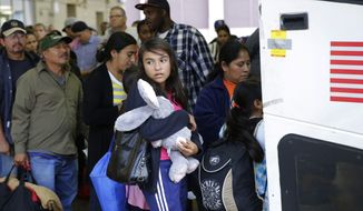 Immigrants from El Salvador and Guatemala who entered the country illegally board a bus after they were released from a family detention center in San Antonio. (AP Photo/Eric Gay, File)