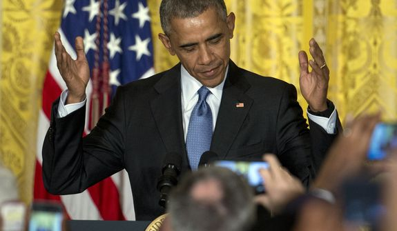 President Barack Obama gestures as he arrives to speak to mayors from around the country, Thursday, Jan. 21, 2016, in the East Room of the White House in Washington. They visited the White House as part of the Winter Meeting of the U.S. Conference of Mayors in Washington this week. (AP Photo/Carolyn Kaster)