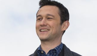 "In this Oct. 8, 2015, file photo, actor Joseph Gordon-Levitt poses for the media on top of the Empire Tower before the premiere of ""The Walk"" at the Moscow International Business Center, Russia. (AP Photo/Alexander Zemlianichenko, File)"