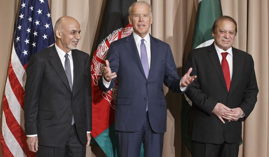 US Vice-President Joe Biden, center, poses with Afghan President Ashraf Ghani, left, and Pakistani Prime Minister Nawaz Sharif for the media prior to a meeting on the sidelines of the World Economic Forum in Davos, Switzerland, Thursday, Jan. 21, 2016. Biden held a trilateral meeting with Ghani Sharif to help the two neighbors co-operate and co-ordinate on counter-terrorism measures, the White House said. (AP Photo/Michel Euler)
