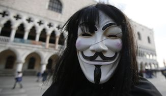 A man wearing an Anonymous mask is seen prior to the Carnival Grand Opening show, in Venice, Italy, Saturday, Jan. 23, 2015. The Venice carnival in the historical lagoon city attracts people from around the world. (Associated Press) **FILE**