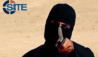 "Mohammed Emwazi, known as ""Jihadi John,"" appeared in several videos depicting the beheadings of Western hostages. The Islamic State group is acknowledging the death of the masked militant and published a ""eulogizing profile"" of him last week. (SITE Intelligence Group via Associated Press)"