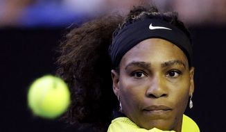Serena Williams of the United States eyes the ball as she returns to Daria Kasatkina of Russia during their third round match at the Australian Open tennis championships in Melbourne, Australia, Friday, Jan. 22, 2016.(AP Photo/Aaron Favila)