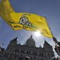 Scott Veley of Kensington, Conn. holds a Gadsden flag during a tea party protest at the Capitol in Hartford, Conn., Thursday, April 15, 2010.  (AP Photo/Jessica Hill)