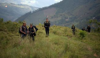 For the first time, guerrillas of the Revolutionary Armed Forces of Colombia are thinking about a future outside their jungle hideout. (Associated Press)