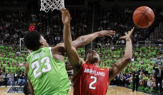 Maryland's Melo Trimble (2) is fouled on a shot by Michigan State's Deyonta Davis (23) during the second half of an NCAA college basketball game, Saturday, Jan. 23, 2016, in East Lansing, Mich. Michigan State won 74-65. (AP Photo/Al Goldis)