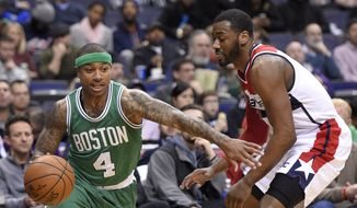 Boston Celtics guard Isaiah Thomas (4) drives to the basket against Washington Wizards guard John Wall (2) during the second half of an NBA basketball game, Monday, Jan. 25, 2016, in Washington. The Celtics won 116-91. (AP Photo/Nick Wass)