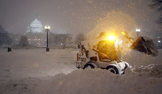 A bobcat piles up snow in front of the U.S. Capitol, as the snow continues to fall, Friday, Jan. 22, 2016, in Washington. (AP Photo/Alex Brandon) ** FILE **