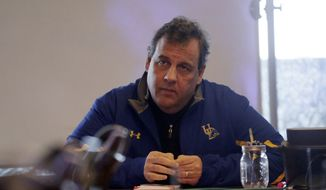 New Jersey Gov. Chris Christie listens to a briefing on a snowstorm during a visit to the New Jersey Department of Transportation Traffic Management and Technology Center, Saturday, Jan. 23, 2016, in Woodbridge, N.J. Towns across the state are hunkering down during a major snowstorm that hit overnight. (AP Photo/Julio Cortez)