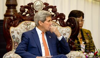 U.S. Secretary of State John Kerry, meets with Lao Prime Minister Thongsing Thammavong at the Prime Minister's Office in Vientiane, Laos, Monday, Jan. 25, 2016. Kerry is in Laos on the third leg of his latest round-the-world diplomatic mission, which will also take him to Cambodia and China. (AP Photo/Jacquelyn Martin, Pool)