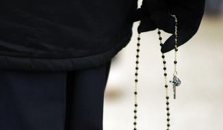 "A nun from Little Sisters of the Poor based in Scranton, Pa., holds her rosary beads as she participates in a ""March For Life"" walk on Friday, Jan. 22, 2016, in Dunmore, Pa.  Friday marked the 43rd anniversary of the United States Supreme Court's decision to legalize abortion.  (Butch Comegys / The Times & Tribune via AP)  MANDATORY CREDIT"