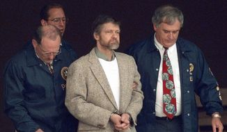 In this June 21, 1996, file photo, Theodore Kaczynski looks around as U.S. marshals prepare to take him down steps at the federal courthouse to a waiting vehicle in Helena, Mont. In handwritten letters to hundreds of supporters and curiosity seekers, Kaczynski expressed shock over the 9/11 attacks and wrote that he preferred Hillary Clinton over Barack Obama in the 2008 Democratic presidential race. (AP Photo/Elaine Thompson, File)