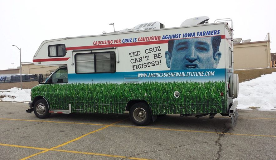 A pro-ethanol Winnebago has been shadowing Ted Cruz's appearances in Iowa to decry the candidate's stance on the alternative fuel popular with Hawkeye State farmers who grow its compounds. (S.A. Miller/The Washington Times)