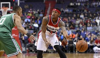 Washington Wizards guard Bradley Beal (3) passes the ball against Boston Celtics guard Avery Bradley (0) during the first half of an NBA basketball game, Monday, Jan. 25, 2016, in Washington. The Celtics won 116-91. (AP Photo/Nick Wass)