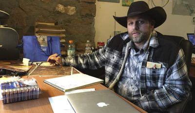 Ammon Bundy sits at a desk he has been using at the Malheur National Wildlife Refuge in Oregon on Friday, Jan. 22, 2016. Bundy is the leader of an armed group occupying a national wildlife refuge to protest federal land policies. (Associated Press)