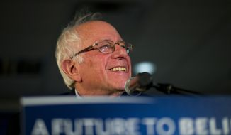 Democratic presidential candidate Sen. Bernie Sanders, I-Vt., smiles while listening to a question from the crowd at a campaign event, Saturday, Jan. 23, 2016, in Maquoketa, Iowa. (AP Photo/Jae C. Hong)