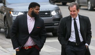 New York Jets NFL football player Sheldon Richardson, left, walks towards the St. Charles County courthouse with his lawyer Scott Rosenblum, Tuesday, Jan. 26, 2016, in St. Charles, Mo., before his hearing on misdemeanor driving charges. Richardson will avoid jail after pleading guilty to reduced charges connected to a high-speed police chase in suburban St. Louis. (David Carson/St. Louis Post-Dispatch via AP)  EDWARDSVILLE INTELLIGENCER OUT; THE ALTON TELEGRAPH OUT; MANDATORY CREDIT