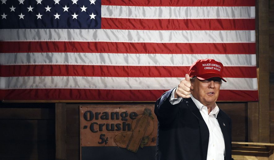 Republican presidential candidate Donald Trump arrives on stage before speaking during a campaign stop on Wednesday, Jan. 27, 2016, in Gilbert, S.C. (AP Photo/Rainier Ehrhardt)