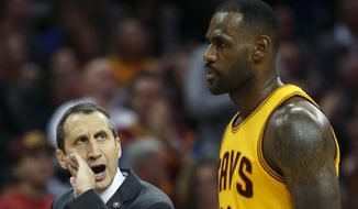 Cleveland Cavaliers head coach David Blatt talks to forward LeBron James during the second half of an NBA basketball game against the Utah Jazz, Tuesday, Nov. 10, 2015, in Cleveland. The Cavaliers won 118-114. (AP Photo/Ron Schwane)