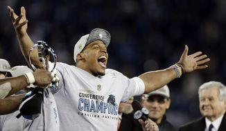 Carolina Panthers' Cam Newton celebrates after the NFL football NFC Championship game against the Arizona Cardinals, Sunday, Jan. 24, 2016, in Charlotte, N.C. The Panthers won 49-15 to advance to the Super Bowl. (AP Photo/Bob Leverone)