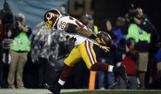Washington Redskins' Chris Thompson scores a touchdown in the second half of an NFL football game against the Philadelphia Eagles, Saturday, Dec. 26, 2015, in Philadelphia.  (AP Photo/Michael Perez)