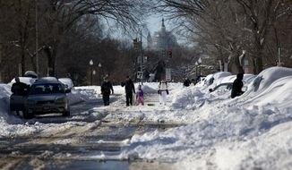 Streets were plowed but sidewalks were covered, forcing pedestrians into streets, after a mammoth blizzard hit the District of Columbia last month. (Associated Press)