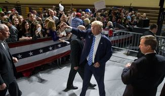 Republican presidential candidate Donald Trump waves to members of the audience as he departs after speaking at a rally at Muscatine High School in Muscatine, Iowa, Sunday, Jan. 24, 2016. (AP Photo/Andrew Harnik) ** FILE **