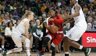 Baylor's Kristy Wallace (4) of Australia, and Kalani Brown, right, defend as Texas Tech guard Japreece Dean (24) drives to the basket during the first half of an NCAA college basketball game, Wednesday, Jan. 27, 2016, in Waco, Texas. (AP Photo/Tony Gutierrez)