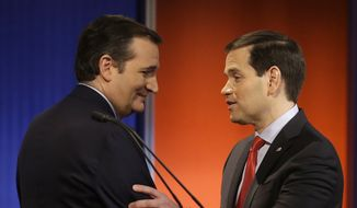 Ted Cruz and Marco Rubio talk after a Republican presidential primary debate, Thursday, Jan. 28, 2016, in Des Moines, Iowa. (AP Photo/Chris Carlson)