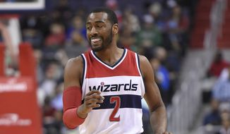 Washington Wizards guard John Wall (2) dribbles the ball during the first half of an NBA basketball game against the Boston Celtics, Monday, Jan. 25, 2016, in Washington. (AP Photo/Nick Wass)