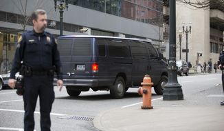 A vehicle transports defendent's arrested yesterday in Harney County after their appearance in the Mark O. Hatfield U.S. Courthouse in Portland, Ore., Wednesday, Jan. 27, 2016.  (Kristyna Wentz-Graff/The Oregonian via AP)