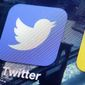 this Friday, Oct. 18, 2013, file photo, shows a Twitter app on an iPhone screen, in New York. (AP Photo/Richard Drew, File)
