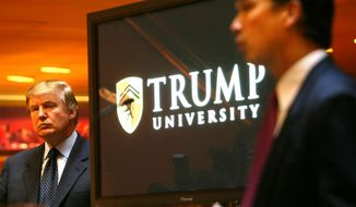 In this May 23, 2005, file photo, Donald Trump, left, listens as Michael Sexton, president and co-founder of the business education company, introduces him to announce the establishment of Trump University at a press conference in New York. (AP Photo/Bebeto Matthews)