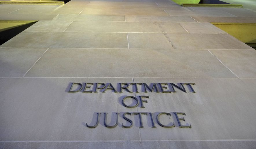 The Department of Justice headquarters building in Washington is photographed early in the morning. (AP Photo/J. David Ake, File)