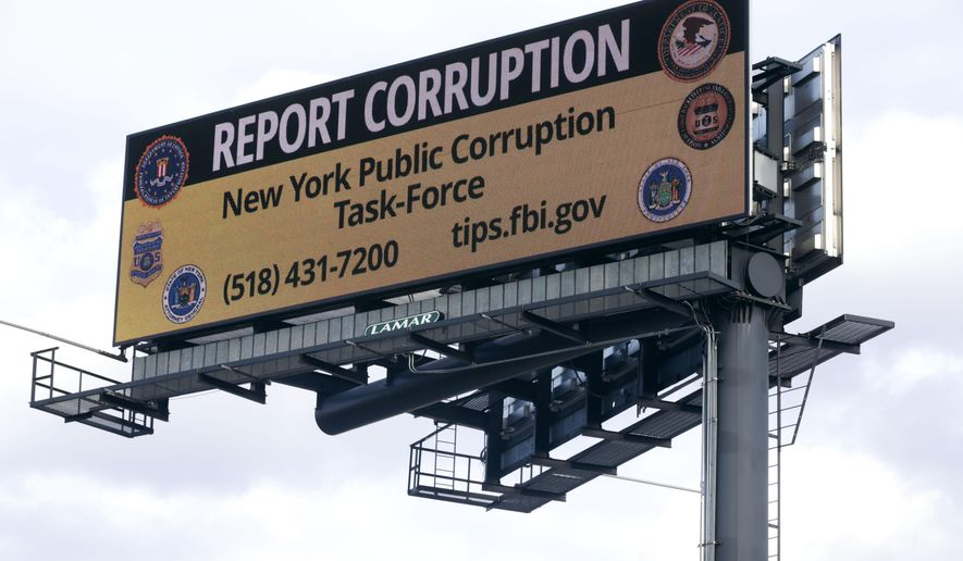 In this Wednesday, Jan. 27, 2016, photo, a billboard with a message about reporting public corruption stands along Interstate 90 in Albany, N.Y. Authorities in New York's corruption-plagued capital city are using billboards to urge citizens to report crooked politicians, using a tactic more commonly employed to find missing people or fight drunk driving. (AP Photo/Mike Groll)