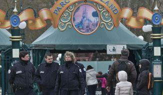 French police officers patrol outside Disneyland Paris, in Marne-la-Vallee, east of Paris, Friday, Jan. 29, 2016. A man who tried to bring two handguns into a hotel at Disneyland Paris was detained Thursday Jan. 28 along with his female partner, authorities said, amid lingering jitters around the French capital following attacks last year. No one was hurt in the incident, and the park Europe's most-visited tourist attraction remained open after the arrests. (AP Photo/Michel Euler)