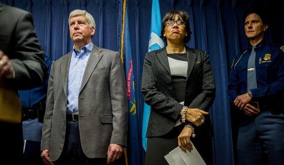 Michigan Gov. Rick Snyder and Flint Mayor Karen Weaver (The Flint Journal-MLive.com via Associated Press/File)