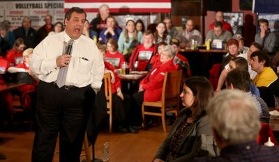 """Republican presidential candidate Chris Christie, in one of his final campaign pitches before the Iowa caucuses, compares his leadership credentials as New Jersey governor with that of Donald Trump, """"whose only experience is being in a fake boardroom in New York City looking into a camera and saying, 'You're fired.'"""" (Associated Press/File)"""