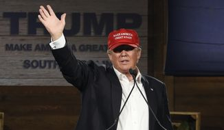 Republican presidential candidate Donald Trump waves after speaking during a campaign stop on Wednesday, Jan. 27, 2016, in Gilbert, S.C. (AP Photo/Rainier Ehrhardt)