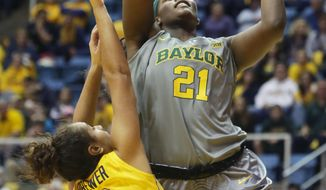 Baylor forward/center Kalani Brown (21) takes a shot while being guarded by West Virginia guard Alexis Brewer (2) during the first half of an NCAA college basketball game, Saturday, Jan, 30, 2016, in Morgantown, W.Va. (AP Photo/Raymond Thompson)