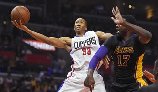 Los Angeles Clippers forward Wesley Johnson, left, shoots as Los Angeles Lakers center Roy Hibbert defends during the first half of an NBA basketball game Friday, Jan. 29, 2016, in Los Angeles. (AP Photo/Mark J. Terrill)
