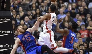 Detroit Pistons' Aron Baynes (12) falls after fouling Toronto Raptors' DeMar DeRozan (10) during the second half of an NBA basketball game in Toronto on Saturday, Jan. 30, 2016. (Frank Gunn/The Canadian Press via AP)