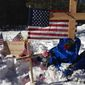 "A makeshift roadside memorial for rancher Robert ""LaVoy"" Finicum stands on a highway north of Burns, Oregon. Mr. Finicum was killed Tuesday in a confrontation with the FBI and Oregon State Police. Four people occupying the Malheur National Wildlife Refuge held their position Sunday. (Associated Press)"