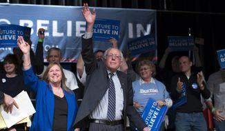 Democratic presidential candidate Sen. Bernie Sanders, I-Vt., and his wife Jane Sanders wave to the crowd during a campaign rally at the Burlington Memorial Center, on Thursday, Jan. 28, 2016, in Burlington, Iowa. (AP Photo/Evan Vucci)