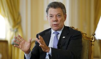 Colombia's President Juan Manuel Santos answers a question during an interview at the Presidential Palace in Bogota, Colombia, Thursday, Jan. 28, 2016. (AP Photo/Fernando Vergara)