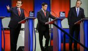 Republican presidential candidate Sen. Ted Cruz, R-Texas, left, answers a question as Sen. Marco Rubio, R-Fla., center, listens and former Florida Gov. Jeb Bush, right, looks on during a Republican presidential primary debate, Thursday, Jan. 28, 2016, in Des Moines, Iowa. (AP Photo/Charlie Neibergall)